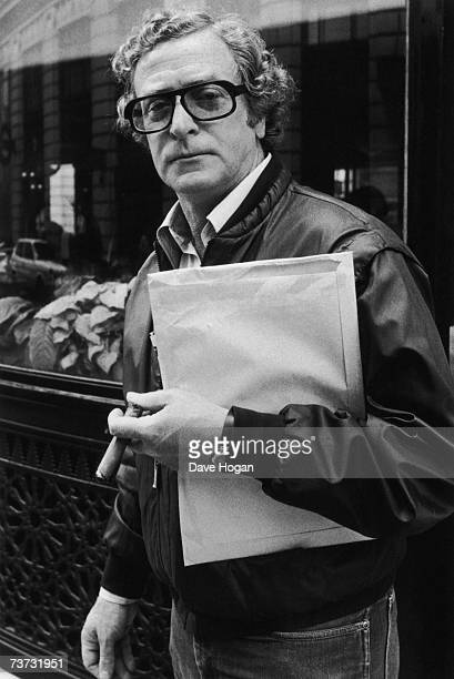 British actor Michael Caine in the street 1984 He is holding an envelope and a cigar