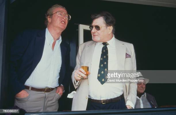 British actor Michael Caine with Americanborn British philanthropist Sir Paul Getty at the first match to be played at Getty's new cricket ground on...