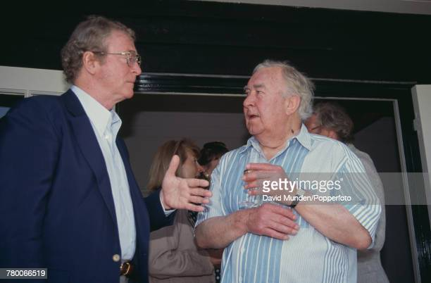 British actor Michael Caine with former cricketer and footballer Denis Compton at the first match to be played at Sir Paul Getty's new cricket ground...