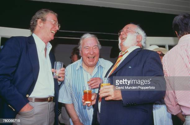 British actor Michael Caine with former England cricketers Denis Compton and Godfrey Evans at the first match to be played at Sir Paul Getty's new...