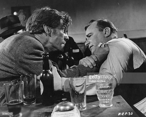 British actor Michael Gough confronts Seamus Kavanagh in the film 'No Resting Place' a fictionalised story of Irish itinerant workers directed by...