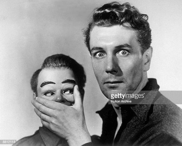 British actor Michael Redgrave plays a ventriloquist who falls under the control of his dummy in the film 'Dead of Night' This segment was directed...