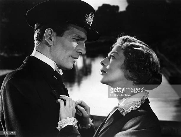 British actor Michael Rennie shares a romantic scene with Wendy Hiller in the film 'SingleHanded' aka 'Brown on Resolution' or 'Sailor of the King'...