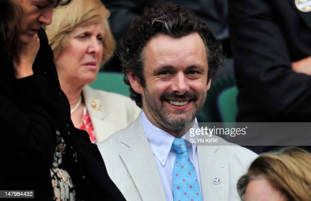 British actor Michael Sheen in the Royal Box on Centre Court before the women's singles final between US player Serena Williams and Poland's...
