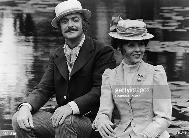 British actor Michal Caine and American actor Diane Keaton wear boaters and sits in a boat in a publicity still from 'Harry and Walter Go To New...
