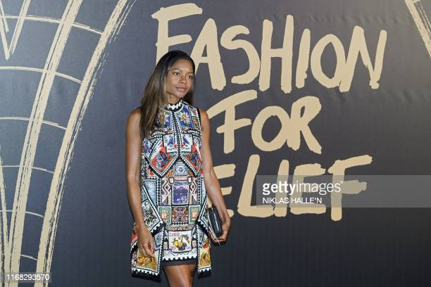 British actor Naomie Harris poses on arrival for the Fashion For Relief charity gala event on the second day of London Fashion Week in London on...