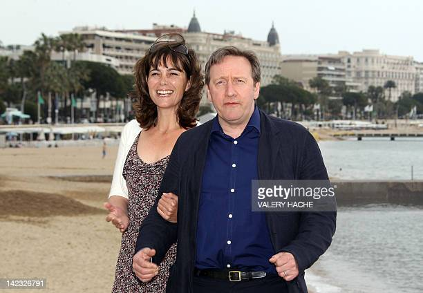 """British actor Neil Dudgeon and actress Fiona Dolman, pose during a photocall for their serie """"Midsomer Murders, Inspector Barnaby"""", during the MIPTV,..."""
