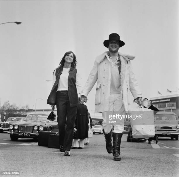 British actor Oliver Reed and girlfriend ballet dancer Jackie Daryl leaving Heathrow airport London UK 17th May 1971