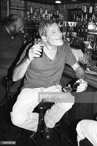 British actor Oliver Reed enjoying a pint in a pub on August 28 1984