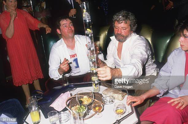 British actor Oliver Reed out drinking with friends circa 1990