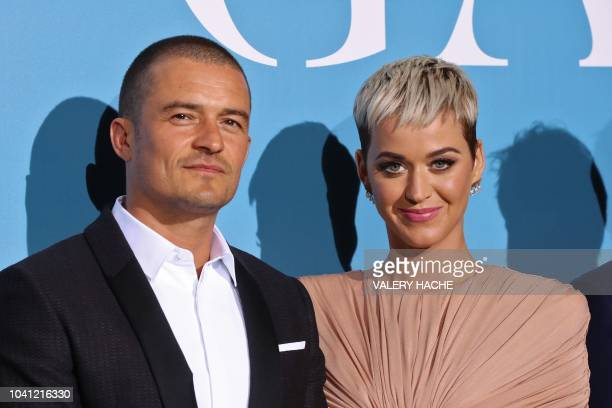 British actor Orlando Bloom and US singer Katy Perry pose upon their arrival at the 2nd Monte-Carlo Gala for the Global Ocean 2018 held in Monaco on...