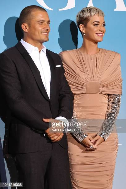 British actor Orlando Bloom and US singer Katy Perry pose upon their arrival at the 2nd MonteCarlo Gala for the Global Ocean 2018 held in Monaco on...