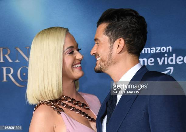 British actor Orlando Bloom and US singer/songwriter Katy Perry arrive for the Los Angeles premiere of Amazon Original Series Carnival Row at the TCL...