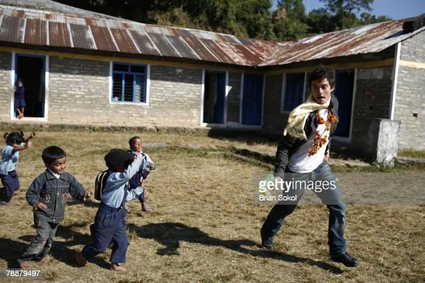 British actor Orlando Bloom wearing flower garlands and a red tikka mark on his forehead plays games with first grade schoolchildren in the...