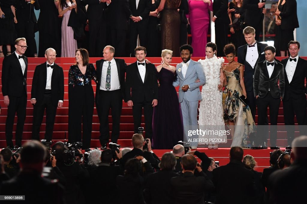 British actor Paul Bettany, US director Ron Howard, US producer Kathleen Kennedy, US actor Woody Harrelson, US actor Alden Ehrenreich, British actress Emilia Clarke, US actor Donald Glover, British actress Phoebe Waller-Bridge, British actress Thandie Newton, Finnish actor Joonas Suotamo, US writer Jon Kasdan and US producer Simon Emanuel pose as they leave the Festival Palace on May 15, 2018 after the screening of the film 'Solo : A Star Wars Story' at the 71st edition of the Cannes Film Festival in Cannes, southern France.