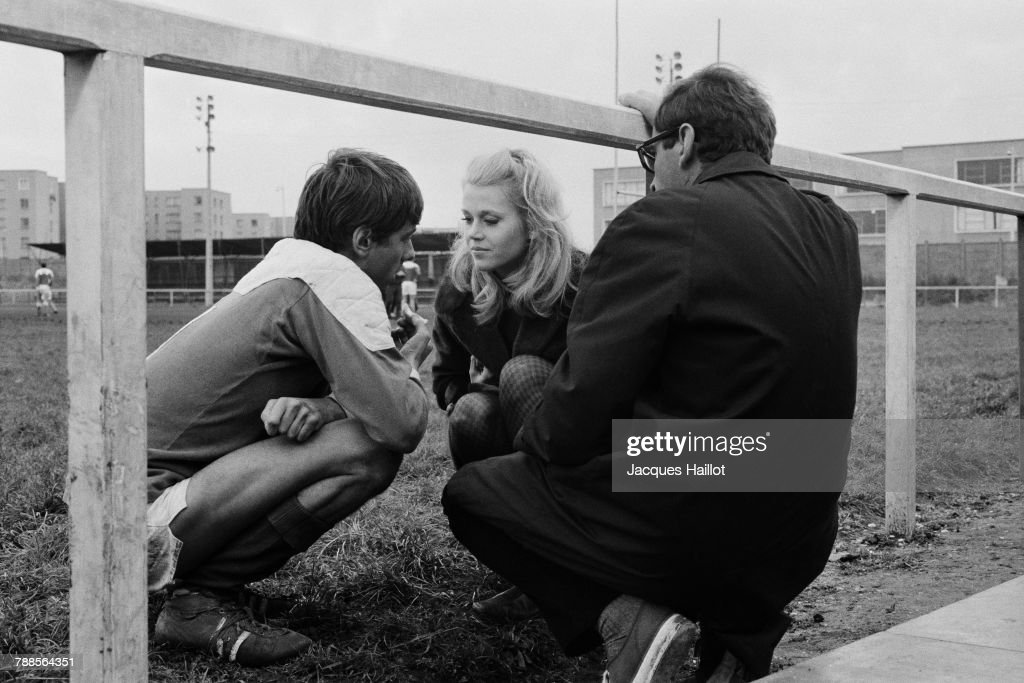 British actor Peter McEnery and American actress Jane Fonda with director Roger Vadim on the set of his movie La CurÌÄå©e, based on the novel by Emile Zola.