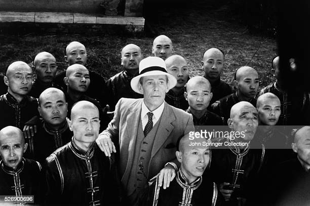 British actor Peter O'Toole as RF Johnston and unidentified actors watch as the emperor walks on the roof of the Forbidden City in the epic film The...