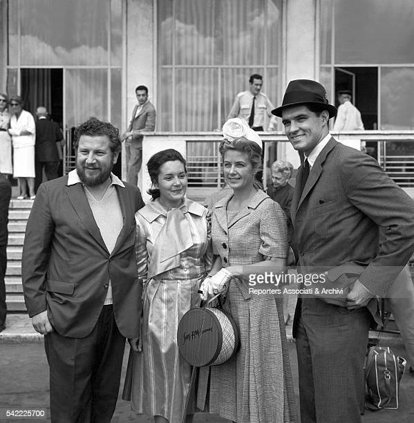British actor Peter Ustinov and his wife Canadian actress Suzanne Cloutier with American actor John Gavin and his wife American actress Cicely Evans...