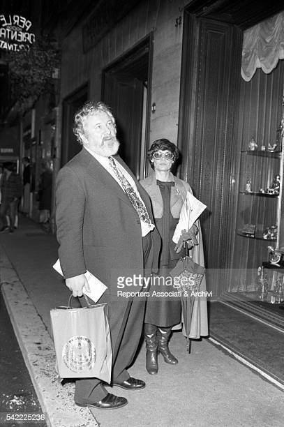 British actor Peter Ustinov and his wife Helene du Lau d'Allemans having a walk in the center of Rome Rome 12th February 1977
