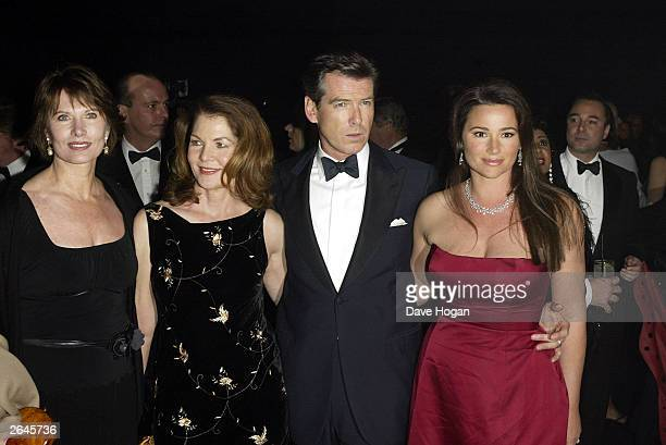 """British actor Pierce Brosnan, his wife and Lois Maxwell attend the world premiere party for the film """"Die Another Day"""" at the Bond Marquee Albert..."""