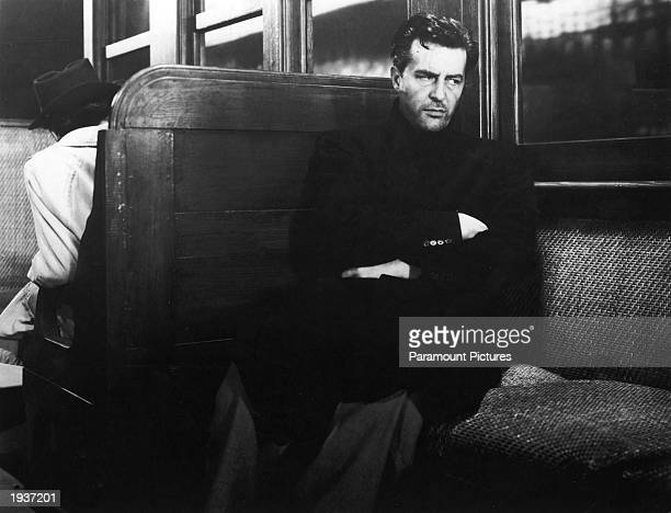 British actor Ray Milland sits unshaven and sullen in a subway train car, in a still from director Billy Wilder's film, 'The Lost Weekend,' 1945.
