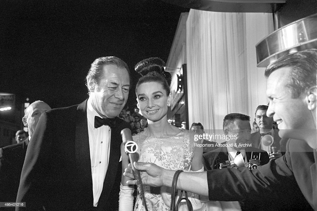 British actor Rex Harrison and British actress Audrey Hepburn at the premiere of the film My Fair Lady. Hollywood, 1964