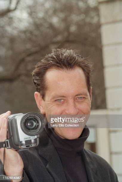 British actor Richard E Grant attends a photocall with a video camera to launch Dennis Potter's new television drama plays Karaoke and Cold Lazarus...