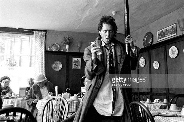 British actor Richard E Grant films a scene in Stony Stratford Buckinghamshire for the movie 'Withnail I' 1986 The cafe is doubling as the 'Penrith...