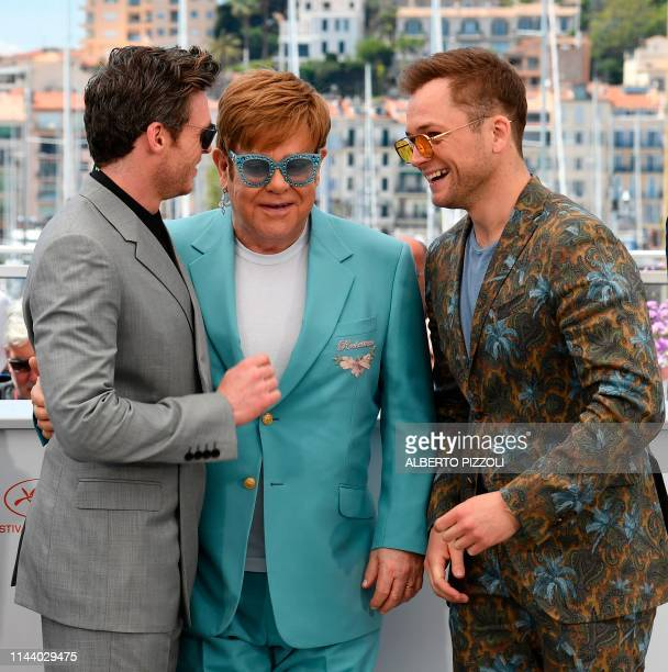 British actor Richard Madden British rock singersongwriter Elton John and British actor Taron Egerton laugh during a photocall for the film Rocketman...