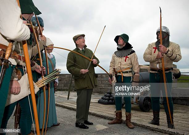 British actor Robert Hardy a longbow expert speaks with Purbrook Bowmen after they fired a volley of fire arrows from Southsea Castle into The Solent...
