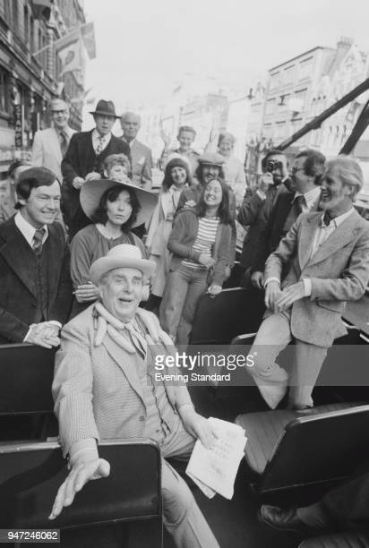 British actor Robert Morley sits on an open topped bus with costars in play 'Banana Ridge' London UK 1st June 1977