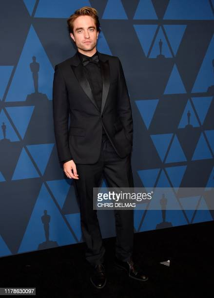 British actor Robert Pattinson arrives to attend the 11th Annual Governors Awards gala hosted by the Academy of Motion Picture Arts and Sciences at...