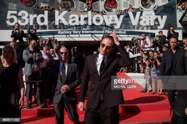 British actor Robert Pattinson poses at the red carpet during the closing of the 53rd Karlovy Vary International Film Festival in Karlovy Vary on...