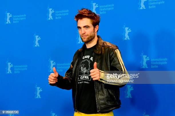 TOPSHOT British actor Robert Pattinson poses during a photocall before a press conference to present the feminist western Damsel during the 68th...