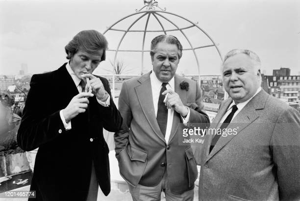 British actor Roger Moore , American film producer Cubby Broccoli and Canadian film producer Harry Saltzman at the announcement that 'Live and Let...
