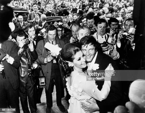 British actor Roger Moore and his new wife Italian actress Luisa Mattioli are surrounded by the press as they dance at Caxton Hall in London...