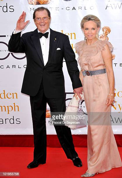 British actor Roger Moore and his wife Kristina Tholstrup arrive at the Closing Ceremony of the 2010 Monte Carlo Television Festival held at Grimaldi...