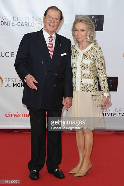 British actor Roger Moore and his wife Kristina Tholstrup arrive at the opening ceremony of the 2012 Monte Carlo Television Festival held at Grimaldi...