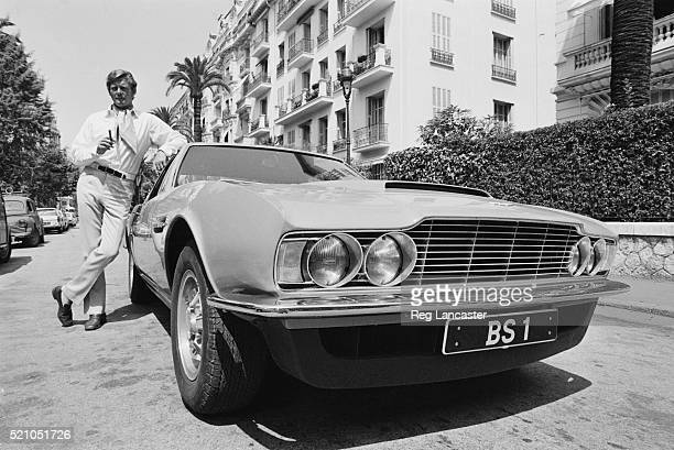 British actor Roger Moore as Lord Brett Sinclair whilst filming the action television series 'The Persuaders' 22nd June 1970 He is posing with an...