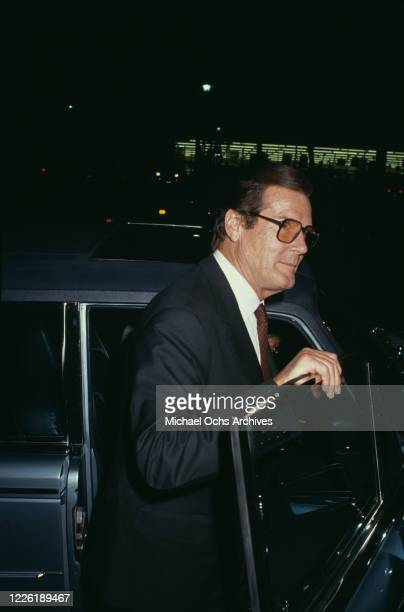 British actor Roger Moore attends the premiere of 'The Fortunate Pilgrim' held at Cineplex Odeon Century Plaza Cinemas in Los Angeles, California,...