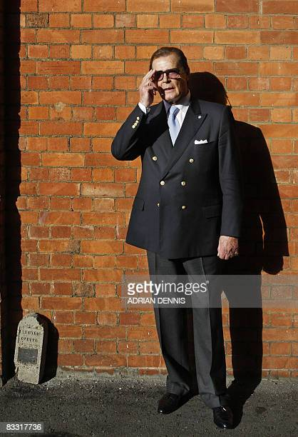 British actor Roger Moore is pictured during a 'James Bond photocall' at Bletchley Park in Milton Keynes on October 17 2008 Six James Bond films are...