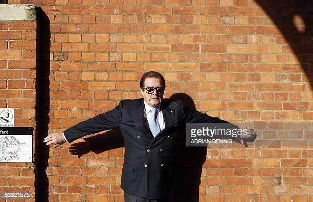 British actor Roger Moore poses for a photograph at a 'James Bond photocall' at Bletchley Park in Milton Keynes on October 17 2008 Six James Bond...