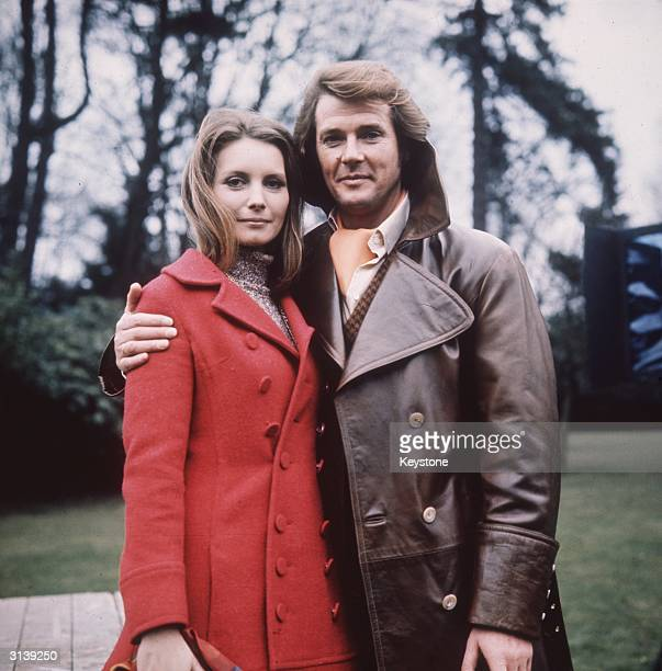 British actor Roger Moore sports a coiffured hairdo as Lord Brett Sinclair in the 70s television series 'The Persuaders' Next to him is German...