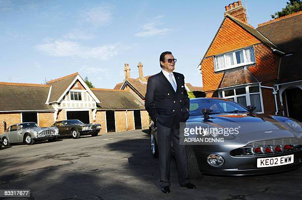 British actor Roger Moore stands beside an Aston Martin car during a 'James Bond photocall' at Bletchley Park in Milton Keynes, on October 17, 2008....