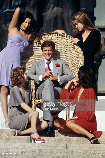 British actor Roger Moore surrounded by James Bond Girls promoting in Paris For Your Eyes Only directed by John Glen