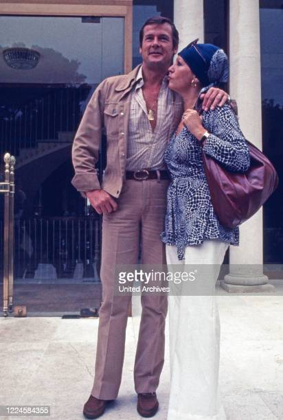British actor Roger Moore with his wife Luisa Mattioli, Germany, 1970s.