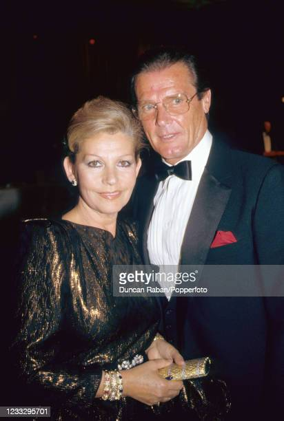 British actor Roger Moore with his wife Luisa Mattioli , in London, circa 1990.