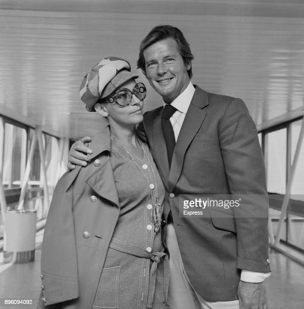 British actor Roger Moore with wife Italian actress Luisa Mattioli at Heathrow Airport London UK 2nd September 1971