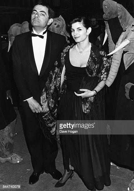 British actor Rowan Atkinson and his partner Sunetra Sastry at the premiere of the film 'The Tall Guy' 1989