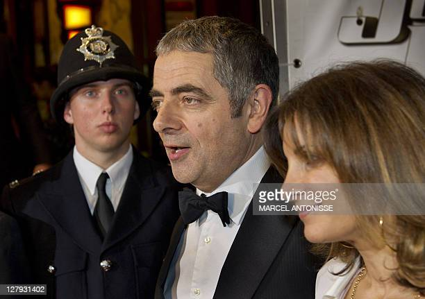 British actor Rowan Atkinson arrives with his wife at theater Tuschinsky in Amsterdam for the premiere of the film Johnny English Reborn on October 3...